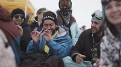 Snowboarders and skiers enjoy event in encamp. Men drink beer. Ski resort Stock Footage