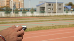 Male athlet run on time at the stadium Stock Footage