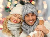 Happy family couple in winter clothes hugging Stock Photos