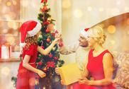 Smiling family decorating christmas tree Stock Photos