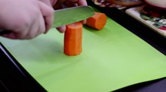 Cutting carrot cubes Stock Footage