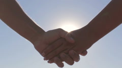 Couple on a date holding hands solar flare Stock Footage