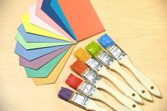 Color Samples and Paintbrushes Stock Photos