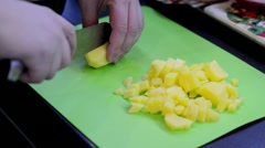 Cutting potato cubes Stock Footage