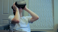 Teenage boy watching movie on VR goggles. Stock Footage
