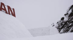 Snowboarder make somersault from springboard. Ski resort. Falling. Extreme stunt Stock Footage