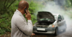 4k, A man calling roadside assistance for help with his car trouble. Stock Footage
