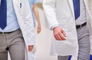 Close up of medics or doctors walking in hospital Stock Photos
