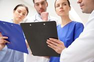Close up of doctors with clipboard at hospital Stock Photos