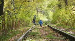 Two children play on the empty rail Stock Footage