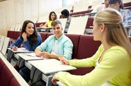 Group of students with notebooks at lecture hall Stock Photos