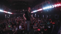 Man jump on crowd hands on party in nightclub. Fun. Entertainment. Audience Stock Footage