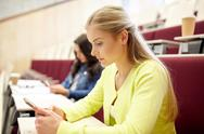 Student girls with smartphones on lecture Stock Photos