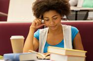 Student girl with books and coffee on lecture Stock Photos