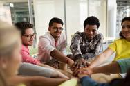 Group of international students with hands on top Stock Photos