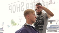 Turkey Barber scissors cuts the hair of the client Stock Footage