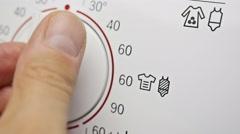 Programming washing machine. Choosing the temperature. Stock Footage