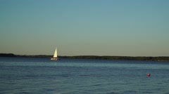 A small sailing boat on the water Stock Footage
