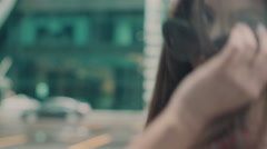 Slow motion. Young sexy girl with long hair in the city. Swordbelt Stock Footage