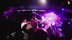 Mc man perform on stage with boys. People dancing on party in nightclub. Cheer Stock Footage