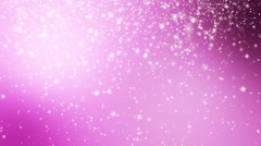 Seamless loop pink Christmas background with small snowflakes star particles Stock Footage