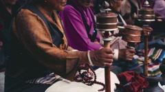 Buddhist prayer wheels, the ceremony at the temple. Women pilgrims prayer wheel Stock Footage