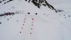Quadrocopter shoot snowboarder jump from springboard, make several flips in air Stock Footage