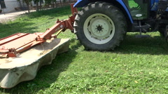 The cutting part of the tractor that cuts grass alfalfa in the garden Stock Footage