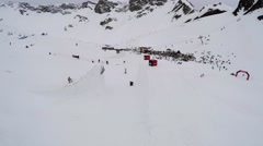 Quadrocopter shoot snowboarder jump from springboard, flip in air. Fall on slope Stock Footage
