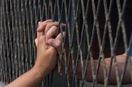 Hands of the man and woman on a steel lattice close up Stock Photos