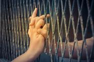 Hands of the man and woman on a steel lattice Stock Photos