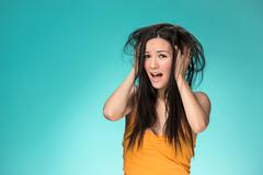 Frustrated young woman having a bad hair Stock Photos