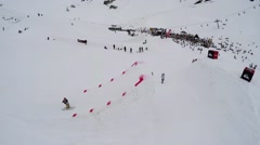 Quadrocopter shoot skier jump from springboard, make extreme stunt in air Stock Footage
