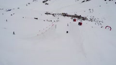 Quadrocopter shoot skier jump from springboard make stunt in air. Encamp. People Stock Footage