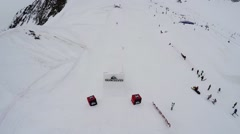 Quadrocopter shoot skier jump from springboard, make somersault in air. People Stock Footage