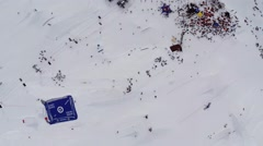 Quadrocopter shoot ski resort. Crowd of people in ancamp. Mountains. Riders Stock Footage