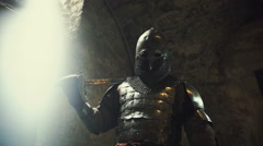 Intimidating warrior in armor holding sword Stock Footage