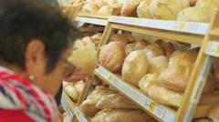 NOVOSIBIRSK, RUSSIA - October 2,2016: choose fresh baked goods Stock Footage