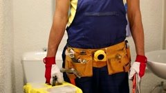 Plumber with tool box standing in bathroom ready to work Stock Footage