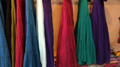 Skirts on hangers in the Indian clothing store Stock Footage