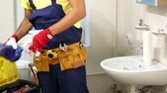 Plumber installing new water filter in bathroom Stock Footage