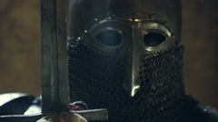 Close up on face of medieval knight face and sword Stock Footage