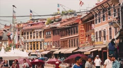 Streets of Kathmandu. Prayer wheels, passers, piligrims, entrance to the temple Stock Footage
