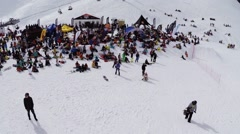 Quadrocopter shoot snowboarders and skiers relax in encamp. Ski resort. Tents Stock Footage