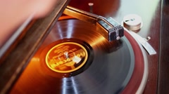 Man sets needle on disk which spins at Elefunken gramophone Stock Footage