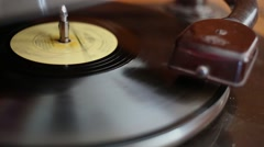 Vinyl music disk circling under needle of gramophone Stock Footage