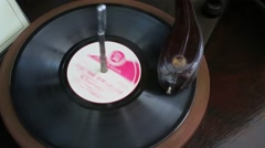 Vinyl audio disk rotates under needle of gramophone Stock Footage