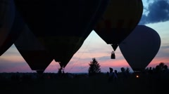 Preparation of air balloons to fly on field with people Stock Footage