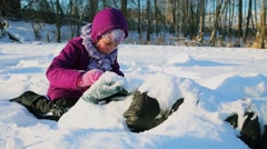 Young boy and girl play in snow at sunny winter day Stock Footage