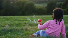 Young child playing with a bubble gun, in slow motion - version 2 Stock Footage